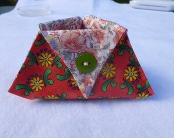 Orange floral thread catcher with cream lining