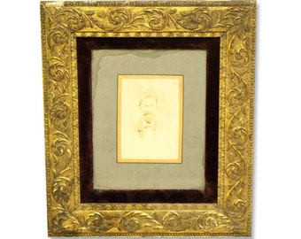 Ornate framed portrait