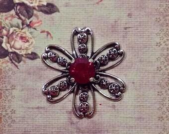 1 Antique Silver Filigree Flower with a Fuchsia (dark pink) Swarovski Stone.