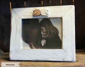 Picture frame with horse head silhouettes