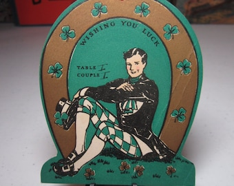 Colorful Art deco gold gilded 1930's Norcross die cut horseshoe shaped St'. Patrick's Day themed bridge tally handsome man in irish outfit