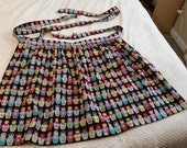 Multi-ethnic Matryoshka Doll Apron with hidden cell phone pocket