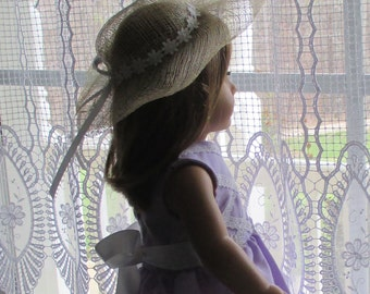 special occasions dress for 18-inch dolls.  Lavender dress with white lattice pattern lace on bodice and stripes on hem.  Straw hat.