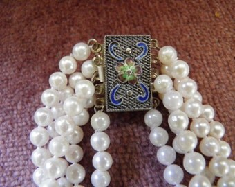 Five Strands Of Saltwater Pearls with Silver Enamel Clasp