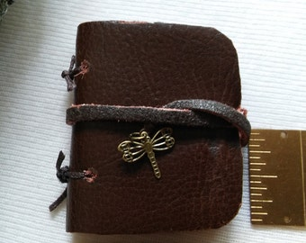 """Distressed Leather Note Book, 2""""x 1.75"""", Hand Bound, Blank White Pages, Strap Closure, 15mm Brass Dragonfly Charm"""