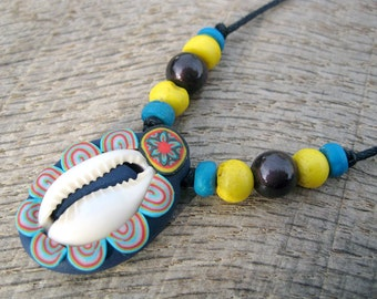 SALE Cowrie shell tribal pendant with millefiori patterns and beads, natural small cowrie shell and polymer clay, handmade and one of a kind