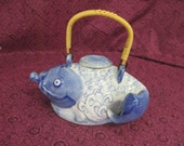 Vintage  blue painted Oriental ceramic fish tea pot  used good condition