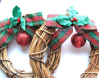 Pair of Holiday wreaths, 8 inch diameter, ribbons and Holly