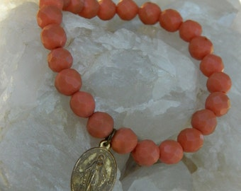 GOLDEN MIRACLE BRACELET vintage repurposed assemblage bracelet handmade stretch jewelry  cross catholic orange glass bead atelier paris