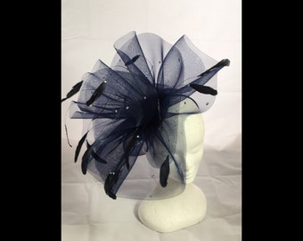Navy blue crinoline fascinator decorated with blue coque feathers and Swarovski crystals
