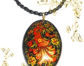 Pendant  in the Russian style khokhloma in handmade with Firebird