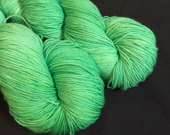 Emerald hand dyed merino sock yarn