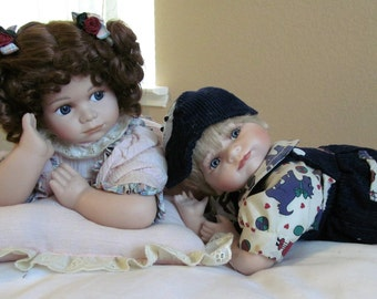 Sweet little ceramic girl and boy dolls