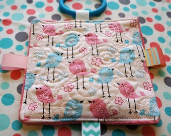 Baby Girl Toys,  1 quilted top crinkle toy in blue and pink bird print, plush minkey backing, comes with a link too.
