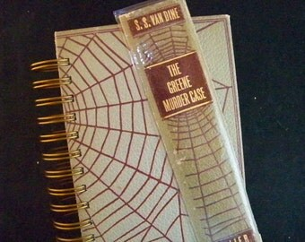 Book journal crafted from murder mystery diary planner