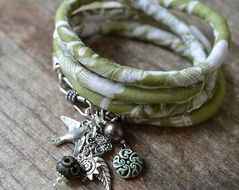 Bohemian multi charm bracelet Fabric cord wrap around bracelet Green wrap bracelet Wide cuff bracelet Hippie silver dangle bracelet