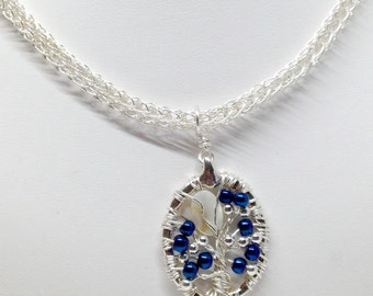 Cobalt blue and silver tree of life wire wrapped pendant with viking knit chain