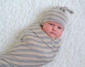 Gender neutral newborn hat. Tan and gray stripes. Soft stretchy knit material.  Made by lippybrand.