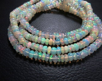 16 Inches Good Quality Natural Stone Ethiopian Opal Smooth Ron dells Beads  size 4 mm 6 mm Approx