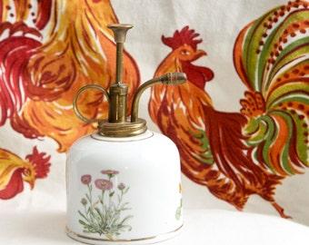 Vintage plant mister, atomizer…porcelain base with brass top.