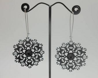 Metal black earrings with crystal pastes