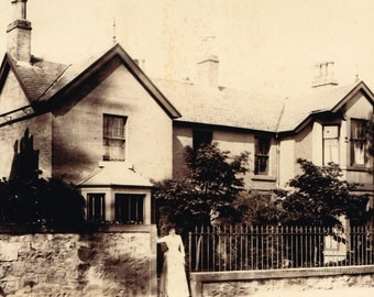 Antique/ estate Victorian/ Edwardian black and white / sepia photo of lady in front of a house