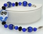 CRAZY EYES GHOST: Artist Lampwork Glass Bracelet Midnight Blue Black