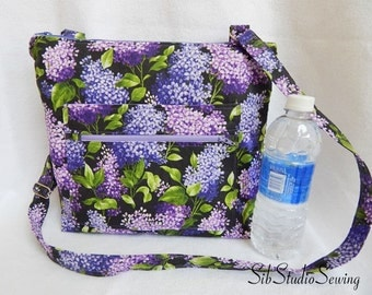 Lilacs Crossbody Bag, 11 H x 13 W x 2 inches, Adjustable Strap, Outer Pockets, Fully Lined, Inside Pockets, Zipper Closure, Hipster Bag