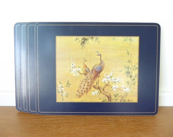 Four navy blue cork backed placemats with Asian bird motif