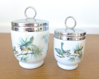 Pair of Royal Worcester porcelain egg coddlers, Birds pattern