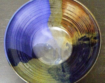 Large bowl in Purple,Blue,Black and Red glaze...