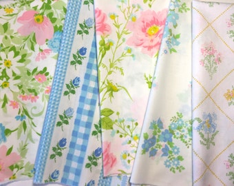 Five pink and blue vintage sheet fat quarters