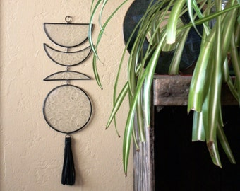 Mid Phase Moon Wall Hanging with textured fused glass pieces and handmade black leather tassel