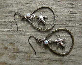 Starfish earrings.  Beachy Earrings.  Hypoallergenic earrings.  Silver and brass earrings.