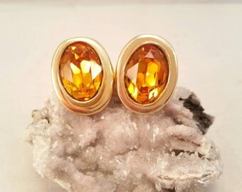 Vintage golden amber topaz glass rhinestone and gold clip on earrings