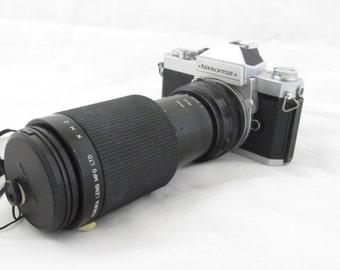 1970s Nikon Nikkormat FT 35mm Film Camera with Komura lens K.M.G Komuranon 821-s ZOOM Lens f-80-210mm