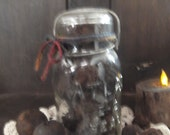 Antique Atlas E Z Seal Quart Canning Jar filled with Black Walnuts