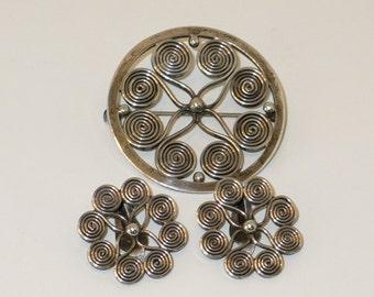 Denmark sterling silver swirl brooch and earrings signed JKP .