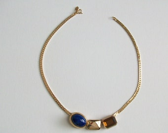 Pretty Avon slide necklace with removable charms in faux lapis, topaz and gold. Vintage from 1980's.