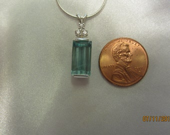 Natural Accented Aquamarine Pendant.