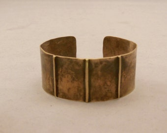 brass cuff bracelet form folded and hammered with a antique patina
