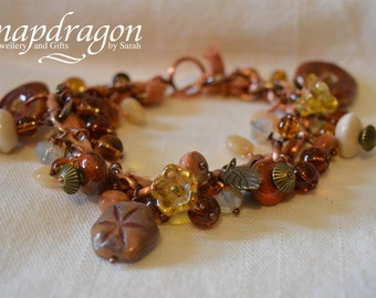 Rustic ceramic beaded copper bracelet with dyed silk ribbon and a copper toggle clasp