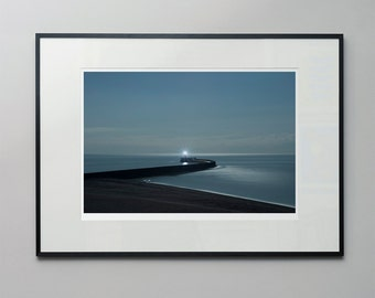Harbour lights - a moonlit, long exposure photograph of Newhaven lighthouse and anglers on the beach