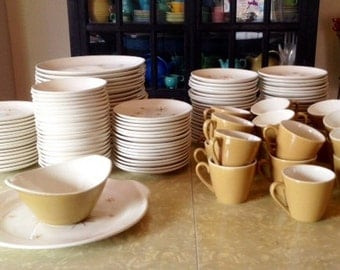 "Gold cups for Royal China's ""Star Glow"" dinnerware"