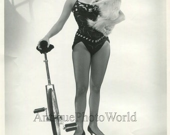 Pretty woman circus performer with unicycle and dog vintage photo