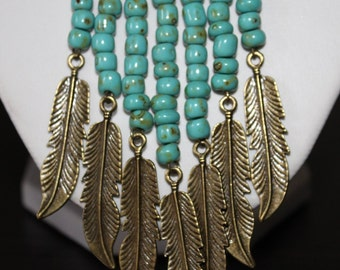 Long chain in the ethno style with bronze feathers and turquoise beads