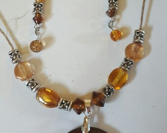Natural Hemp and glass beads with shell medallion necklace and earring set