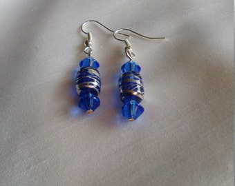 Handcrafted blue glass dangle earrings with silver design