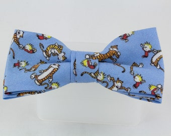 Clip on Bowtie, Calvin and Hobbes Dancing to the music, 4 1/2 inches by 2 inches, Clip on necktie