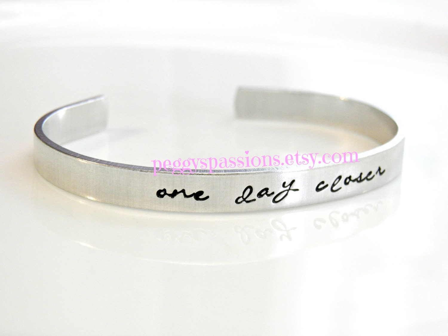 One day closer Hand stamped cuff bracelet Deployed